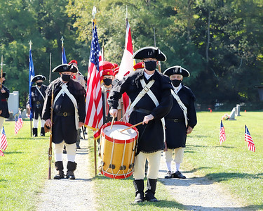 Members of the Sons of the American Revolution march to open Saturday's Veterans' Memorial Dedication at Glade Run Cemetary. Seb Foltz/Butler Eagle. 09/26/20