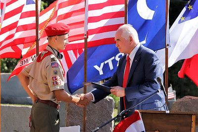 U.S. Rep. Mike Kelly shakes hands and gives and award to Sam Everson of Boy Scout Troop 400. Everson's Eagle Scout project was to organize a new veteran's memorial at Glade Run Cemetary. The project culminated with Saturday's ceremonial unveiling. Seb Foltz/Butler Eagle 09/26/20