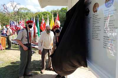 Benjamin Everson and Donny Marshall from Boy Scout Troop 400 unveil the new veteran's Memorial at Glade Run Cemetary Saturday. Seb Foltz/Butler Eagle 09/26/20