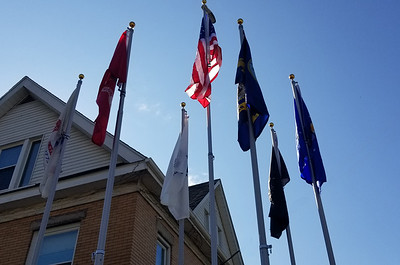Flags from the six branches of the U.S. military, including the first Space Force flag to be flown in Butler County, surround Old Glory on Saturday morning. The new flag display at Robin's Home was dedicated by veterans in the community and attended by the American Legion Riders, neighbors and others.