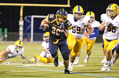 Mars senior runningback Teddy Ruffner breaks a long run for a touchdown to put the Planets up 28-13 over Hampton with 1:03 left in the third quarter. Seb Foltz/Butler Eagle  09/11/20