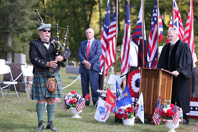 Bag piper George Balderose plays during Rev. Stephen Gutridge's benediction at Saturday's Veterans' Memorial dedication along with U.S. Rep. Mike Kelly. Seb Foltz/Butler Eagle 09/26/20