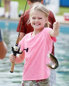 Emmalyn Wood, 9, of East Butler reacts to the rainbow trout she caught during the Alameda Water Park fishing derby Sunday, September 27, 2020. Emmalyn and her siblings, Jaymin,11, Irelayn, 5, and Griffin, 3, joined their parents Josh and Cassie Wood of Butler at the water park.
