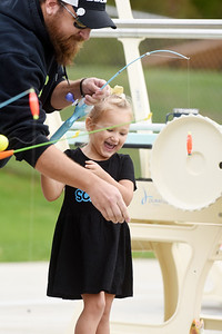 Ava Holland, 3, of Butler reals in a Golden Trout with the help of her father John Holland during the Alameda Water Park fishing derby Sunday, September 27, 2020. Harold Aughton/Butler Eagle