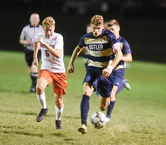 Butler junior Landon Mohney pushes the ball down the field to setup a field goal in the first period against North Hills. Harold Aughton/Butler Eagle