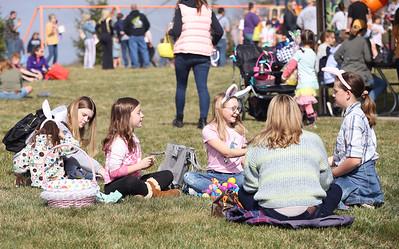 Children sort through their easter egg haul at Saturday's Winfield Township Easter Egg Hunt. Seb Foltz/Butler Eagle