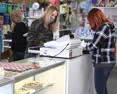 Amber Waugaman of Mary's Cakes & Candy rings up a customer at the Butler store. Seb Foltz/Butler Eagle 03/30/21