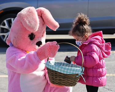 Aveah Clark, 4, picks out a piece of candy from the Easter Bunny's basket at the GFWC Jr. Women's Club of Butler's hoagie sale fundraiser Friday behind The Hoagie Shop in Bon Air Plaza. The group sold over 1,000 hoagies to raise funds for Butler Memorial Hospital's Food Institute program. The program will connect patients with food insecurities to appropriate resources. Seb Foltz/Butler Eagle 04/02/21