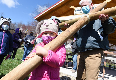 When Rev. Gregg Hartung of the Crestview United Presbyterian Church in Callery asked for volunteers to carry the cross Friday afternoon, Kate Johns, 3, jumped to the head of the line. Kate is the daughter of Christine and Rev. Brandon Johns of St. Peters Lutheran Church in Evans City. Parishioners from St. Peters Lutheran Church, St. Johns United Church of Christ, Westminster Presbyterian Church and Crestview United Presbyterian Church gathered in Callery at Noon on Friday stopping at 4 intersections praying for first responders, essential workers, pastors, political leaders and members of the armed forces during the walk. Friday, April 2, 2021. Harold Aughton/Butler Eagle