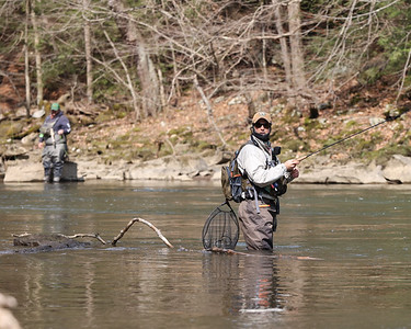 Craig Thompson of Mars looks to shore while fishing Saturday at Eckert Bridge at McConnells Mill. Thompson and other anglers took advantage of milder weather to fish the first day of trout season. Seb Foltz/Butler Eagle 04/03/21