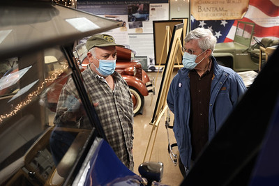 John Pro of Portersville explains the history of the 1922 Standard Eight automobile (pictured) to Lincoln Paul Saturday at the Harmony Museum's Indoor Auto Show Saturday. Seb Foltz/Butler Eagle  04/03/21