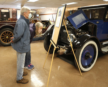 Lincoln and Kathy Paul read about the history of the Butler-built 1922 Standard Eight at the Harmony Museum's Indoor Auto Show Saturday. Seb Foltz/Butler Eagle 04/03/21