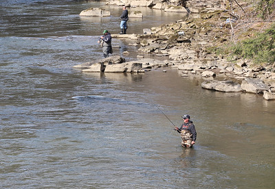 Pat Keller of Portersville (front) and other fisherman take advantage of milder weather to fish the first day of trout season Satuday at McConnells Mill Saturday. Seb Foltz/Butler Eagle 04/03/21