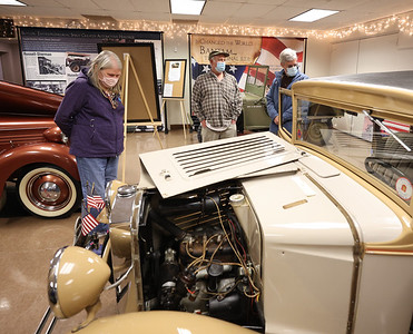 Kathy Paul looks at an 1930 American Austin, built in Butler County, at the Harmony Museum's Indoor Auto Show  with her husband Lincoln Paul (right) and show volunteer John Pro Satruday in Harmony. Seb Foltz/Butler Eagle