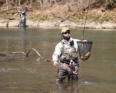 Craig Thompson of Mars calls downriver to his son to show a roughly 20-inch Palomino Trout he caught Saturday at Eckert Bridge at McConnells Mill. Seb Foltz/Butler Eagle 04/03/21
