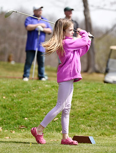 Kennedy Kinney, 10, enjoyed a round of golf with her father, Dean Kinney, brother, Kendrick, 7, and family friend Jon Terwilliger at the Foxburg Country Club Monday afternoon. April 5, 2021. Harold Aughton/Butler Eagle