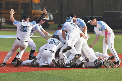Seneca players pile on Quinn Burke after he hit a walk off RBI in the 7th inning to top North Allegheny 2-1. Seb Foltz/Butler Eagle 04/06/21