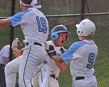 Seneca Valley pitcher Ethan Edkins(center) celebrates with teammates after scoring a walk-off run in the 7th. Seb Foltz/Butler Eagle 4/6/21