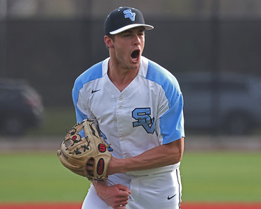 Seneca Valley pitcher Ethan Edkins celebrates after getting the final out in the top of the 5th inning against North Allegheny with runners in scoring. Seneca won 2-1 with Edkins scoring a walk-off run in the 7th. Seb Foltz/Butler Eagle 4/6/21