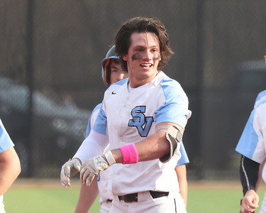 Seneca Valley's Quinn Burke smiles after a celebration pile-on in the Raiders 2-1 win at home against North Allegheny. Burke hit a walk-off RBI to win in the 7th inning. Seb Foltz/Butler Eagle 04/06/21