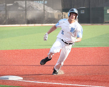 Seneca Valley pitcher Ethan Edkins rounds third base to score the winning run against North Allegheny Tuesday at home. Seneca won 2-1 with Edkins walk-off score in the 7th. Seb Foltz/Butler Eagle 4/6/21