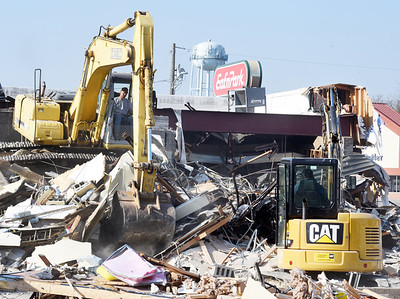 Derek Auen, an operator for CTS Construction, demolishes the Eat-n-Park along New Castle Road Tuesday morning. April 6, 2021. Harold Aughton/Butler Eagle