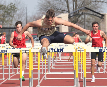 Butler's Byron Manchester clears a hurdle on his way to a win in the 110 meter hurdles during Thursday's home meet against North Hills and Fox Chapel. Seb Foltz/Butler Eagle 04/08/21
