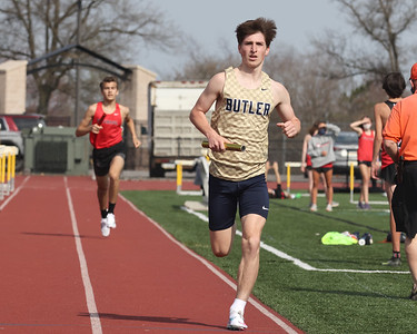 Butler's Skyler Vavro runs the final leg of the 4x800 meter in Thursday's home meet against North Hills and Fox Chapel. Butler won the event and the meet. Seb Foltz/Butler Eagle 04/08/21