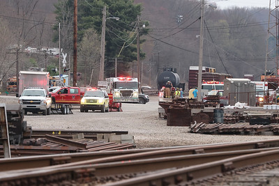 Fire crews gather along Henricks Rd near the intersection with Route 38 to fight a brush fire that started along the train tracks near north of the BHS Outpatient Servicies facility and Route 422. Seb Foltz/Butler Eagle 04/08/21
