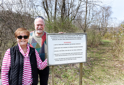Ann Marron, treasurer, and Bob Jennings, president of the Allegheny River Trail in Clarion County, Inc., stand on what will be the entrance of the Allegheny Trail in Foxburg on a property that they recently acquired.  The group also acquired a right away on another nearby property providing the opportunity to complete the 3.5 miles of bike trail between Foxburg and Emlenton. A ground breaking ceremony is planned for Thursday, April 22, 2021. Harold Aughton/Butler Eagle.