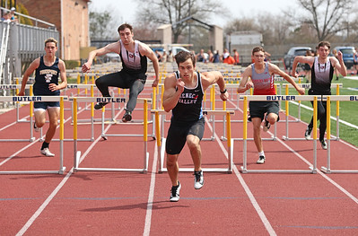 Seneca Valley's Aiden Cutchman (center) pushes to the finish line to win in the 100 meter hurdles in Saturday's Butler Classic track meet.  Schools from across Butler County came to compete in the one day event. Seb Foltz/Butler Eagle 04/10/21