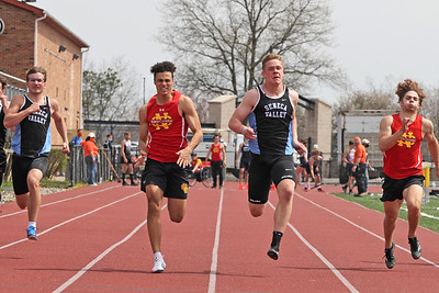 Seneca Valley's Tyler Yurich and North Catholic's Trevor Paschall (center left) push to a photo finish in the 100 meter dash in Saturday's Butler County Classic. Yurich edged out Paschall by fractions of a second to win the event. Schools from across the county participated in the one day event. Seb Foltz/Butler Eagle 04/10/21