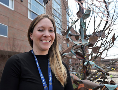 Butler Memorial Hospital paliative care social worker Jenna Rhodaberger stands in front of the new sculpture she helped procure in the hospital's meditation garden. Seb Foltz/Butler Eagle 04/06/21
