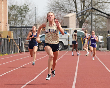 Butler's Emma Lehman runs the final leg of the girls 4x100 meter relay in Saturday's Butler County Classic. The Butler girls relay team won the event. Schools from across the county participated in the one day event. Seb Foltz/Butler Eagle 04/10/21