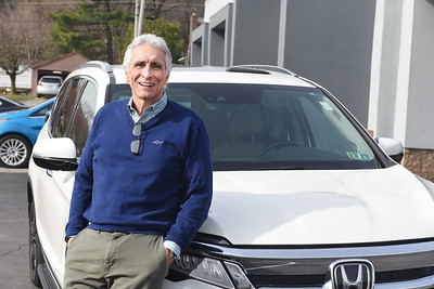 Salesman Bob Kelly of Ellis Auto stands in front of a Honda Pilot. Harold Aughton/Butler Eagle