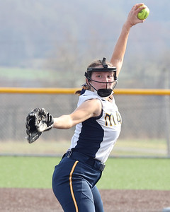 Mars' Kali Harris (4) winds up to pitch Wednesday against Freeport. Mars won with a walk-off run scored in the seventh inning to top Freeport 9-8. Seb Foltz/Butler Eagle 04/07/21