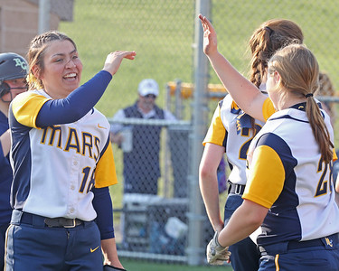 Mars Danielle Bednar high fives Steph Esswein after hitting a game-winning walk-off RBI in the seventh inning to top Freeport 9-8 at home. Seb Foltz/Butler Eagle 04/07/21