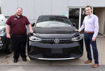 Cory Pytel and Jack Rial of Diehl Automotive stand in front of a Volkswagen ID.4. Harold Aughton/Butler Eagle.
