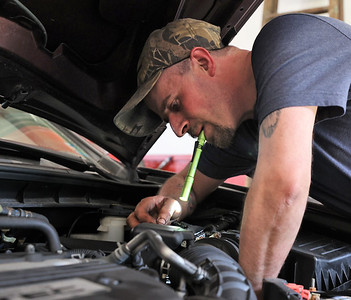Chad Straessley of Milbert's Car Care prepares to flush transmission fluid from a vehicle transmission in their Cranberry-area shop. Seb Foltz/Butler Eagle April 2021