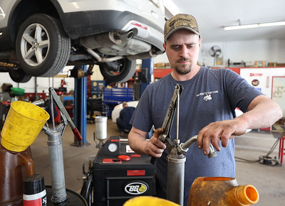 Chad Straessley of Milbert's Car Care prepares to flush transmission fluid from a vehicle. Seb Foltz/Butler Eagle April 2021