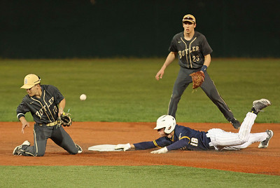 Central Catholic's Nick Chirumbolo 18 dives into second following a wild pitch.  Butler Shortstop Kyle Yost (10) fielding. Seb Foltz/Butler Eagle 04/13/21