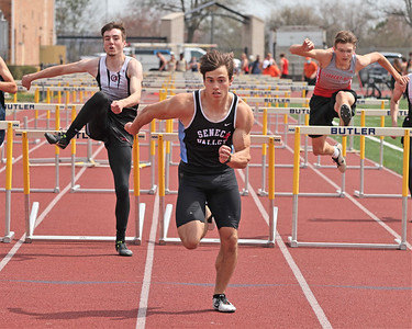 Seneca Valley's Aiden Cutchman (center) clears the final hurdle on his way to a win in the 100 meter hurdles in Saturday's Butler Classic track meet.  Schools from across Butler County came to compete in the one day event. Seb Foltz/Butler Eagle 04/10/21