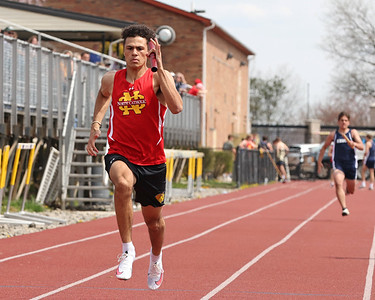 North Catholic's Kyle Tipinski runs the final leg of the boys 4x100 meter relay in Saturday's Butler County Classic. The North Catholic relay team won the event. Schools from across the county participated in the one day event. Seb Foltz/Butler Eagle 04/10/21