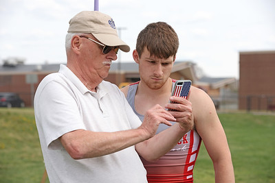 Slippery Rock javelin thrower Josh Kingerski watches video of his last throw with his grandfather George Francis at Saturday's Butler County Classic track meet.Schools from across the county participated in the one day event. Seb Foltz/Butler Eagle 04/10/21