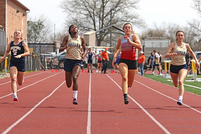 Slippery Rock's Anna Kadlubek pushes to the finish line to earn first place in the 100 meter dash, edging out Butler's Justine Forbes (center left), Taylor Timmons (right) and Freeport's Aleah Parisonin (left). Saturday's Butler County Classic. Forbes and Timmons finished second and third. Schools from across the county participated in the one day event. Seb Foltz/Butler Eagle 04/10/21