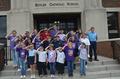 """Butler Catholic students, faculty and staff wore purple on Thursday as part of Purple Up! Day.  Held on April 15th of each year, """"Purple Up! For Military Kids"""" is a day first started by the Department of Defense to support and thank military children for their strength and sacrifices.  Butler Catholic School joined in this year to honor not only their own students who are military children, but also those worldwide who are children of US military members.   Approximately 10% of the Butler Catholic student body are children whose parents are currently serving or have previously served in the US military. Kids in the photograph  are from military families. submitted photo"""