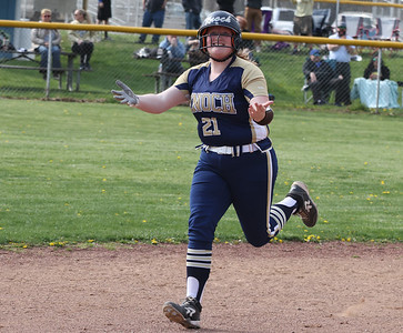 Knoch's Bailey Rickenbrode (21) celebrates while rounding the bases following her grandslam. The homer gave Knoch the lead. The Knights held on to win 6-5. Seb Foltz/Butler Eagle 04/20/21