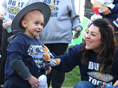 Ford Bartle,4, opens gifts from emergency responders at his birthday party Tuesday with his mother Carli Bartle. Seb Foltz/Butler Eagle 4/20/21
