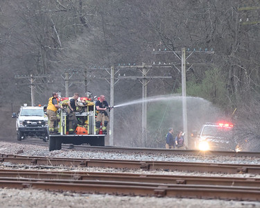 Fire crews douse hot spots from a brush fire that started along the train tracks near Route 38, Highway 422 and the BHS Outpatient Servicies facility. Seb Foltz/Butler Eagle 04/08/21