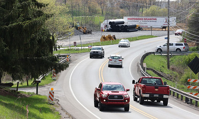 Cars drive by the Route 228 construction site near the intersection with Route 8 Tuesday. When complete the project will straighten 228 and add additional lanes. Seb Foltz/Butler Eagle